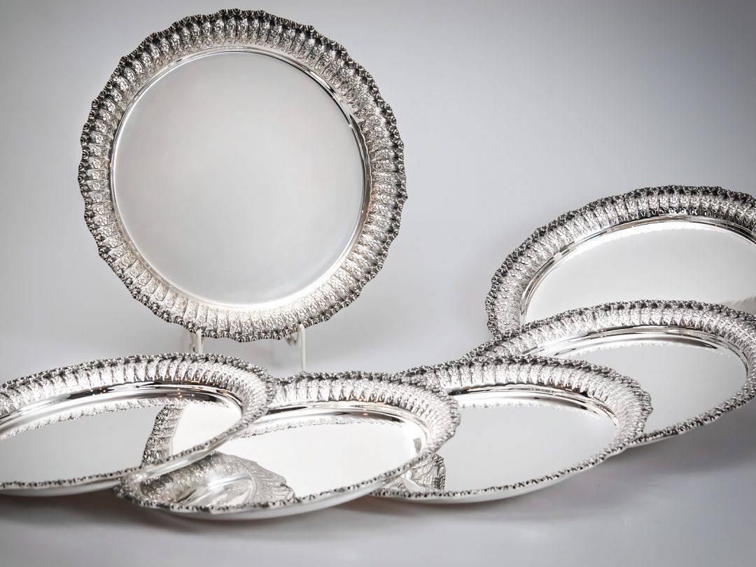 Set di dodici sottopiatti in argento